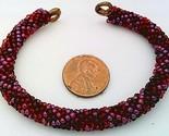 Red colors bead crochet on copper bracelet thumb155 crop