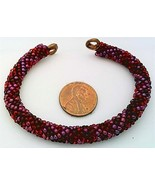 Red colors bead crochet on copper bracelet thumbtall