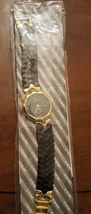 VINTAGE THE ORYX QUARTZ GOLD & BLACK FLEX BAND WRIST WATCH JAPANESE MOVEMENT image 9