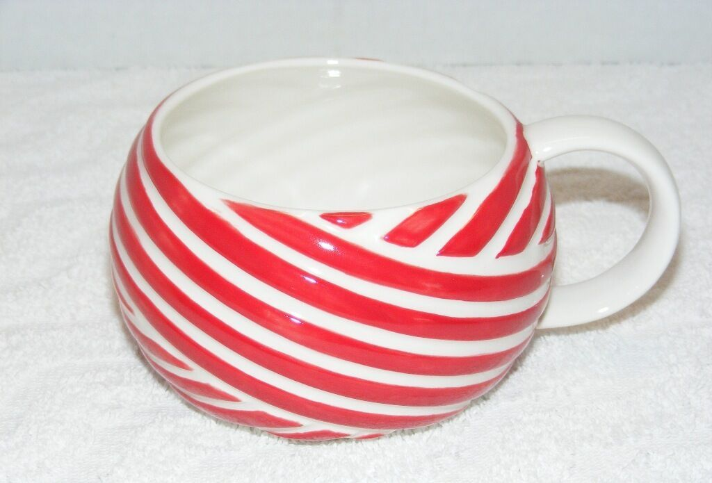Primary image for STARBUCKS COFFEE 2013 RED CANDY CANE CERAMIC CHRISTMAS 12 oz COFFEE MUG EUC