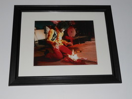 "Framed Jimi Hendrix Monterey Pop Guitar on Fire Mini-Poster, 14"" by 17"" - $27.16"