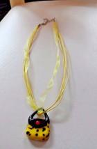 Yellow and black Murano glass purse handbag pendant on a ribbon necklace - $6.95