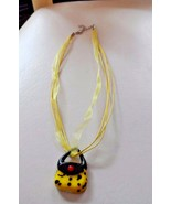 Yellow and black Murano glass purse handbag pendant on a ribbon necklace - $6.95