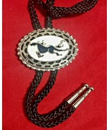 Vintage Southwestern Bolo Tie A galloping horse Enamel Black White & Silver - $17.82