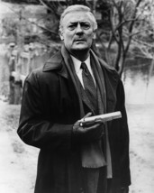 Edward Woodward in The Equalizer as Robert McCall in Black Raincoat Holding Gun  - $69.99