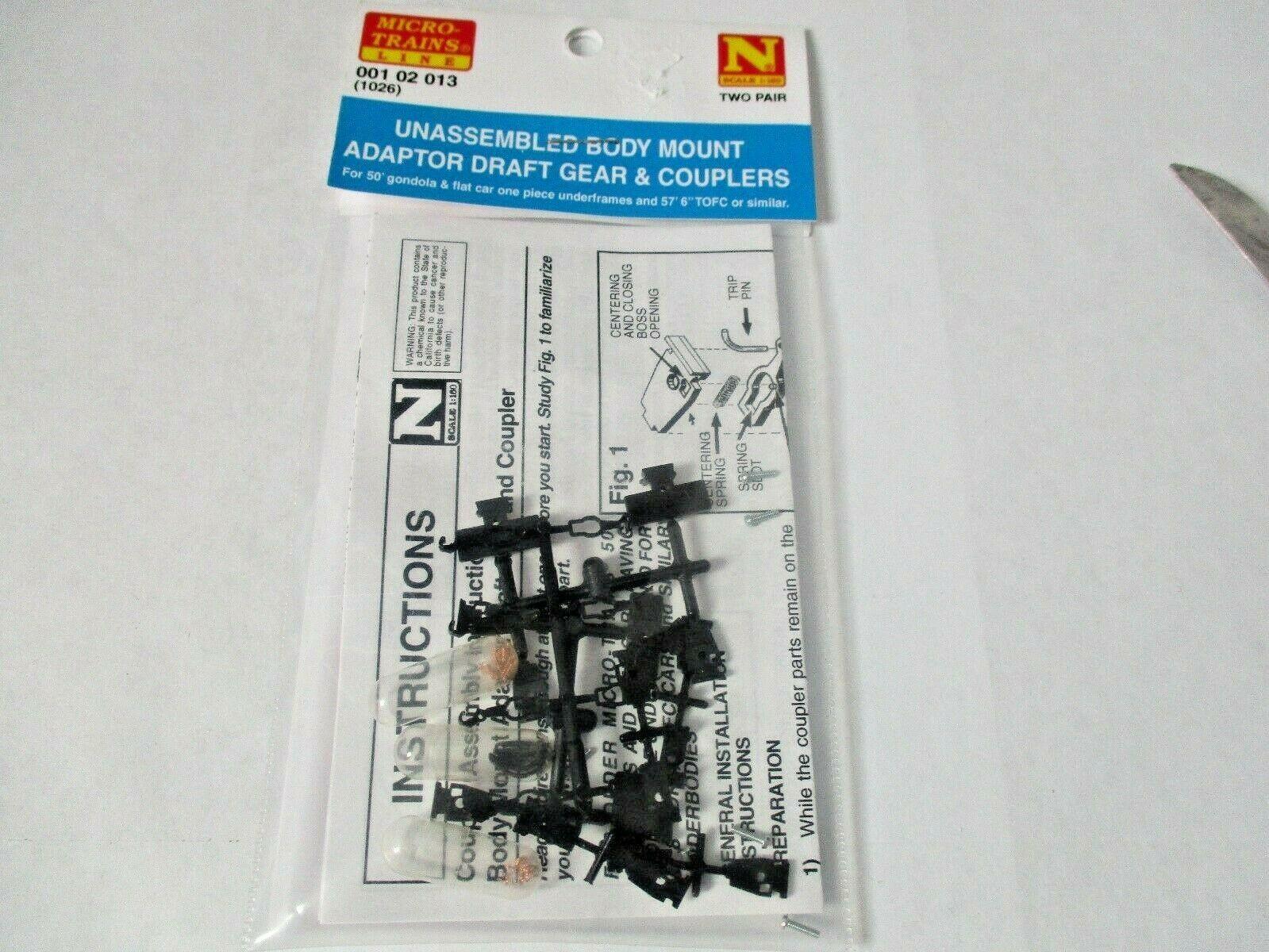 Micro-Trains Stock #00102013 (1026) Unassembled Body Mount Adaptor Draft Gear