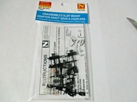 Micro-Trains Stock #00102013 (1026) Unassembled Body Mount Adaptor Draft Gear  image 1