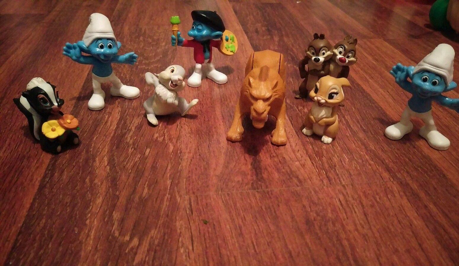 Toy mixed lot Disney Pixar Smurfs 8 piece lot