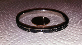 Vintage black crystal inset hinged clamper bracelet. Bracelet measures 8 inches  - $19.00