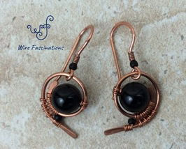 Handmade black onyx earrings: copper wire wrapped swirl - $28.00