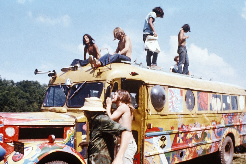 Primary image for Woodstock classic hippies on top of painted school bus 18x24 Poster