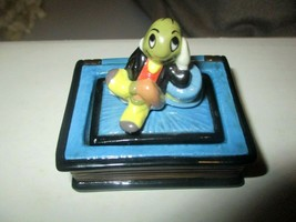 Disney Jiminy Cricket on Pinocchio Book w/Umbrella Trinket Box  Michael ... - $98.01