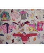 Lot of 10 Barbie ect + shirts - $20.00