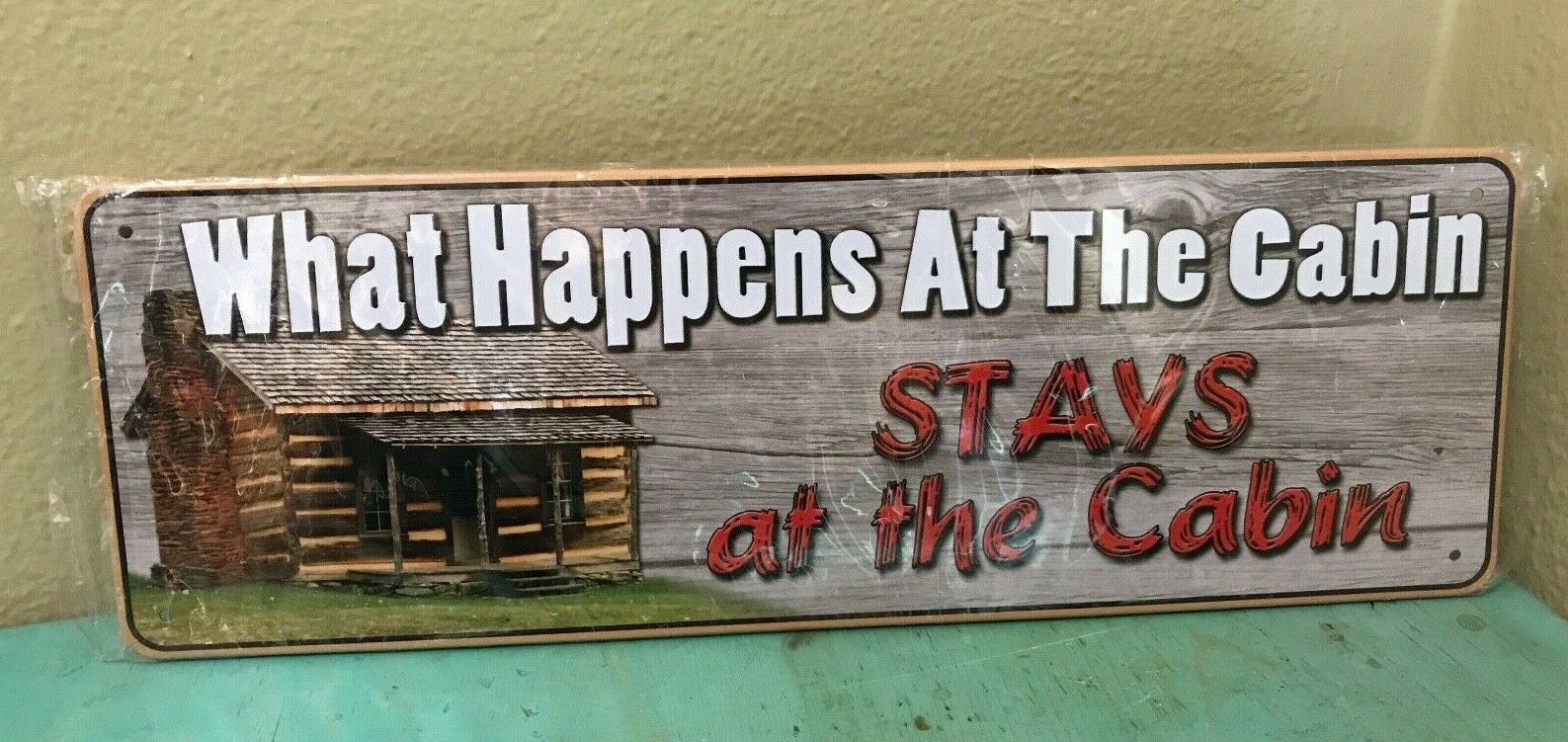 """""""What Happens At the Cabin Stays at the Cabin"""" Funny Metal Tin Sign 10.5"""" x 3.5"""""""