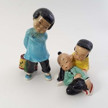 """2 Asian Figurines / Gort """"Little Carp"""" and Girl with Boy laying on lap / as is image 1"""