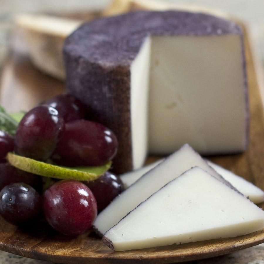 Primary image for Murcia Al Vino - Wine Soaked Goat Cheese - 8 oz cut portion
