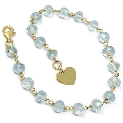 18K YELLOW GOLD BRACELET, OVAL FACETED AQUAMARINE, FLAT HEART PENDANT