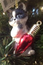 Christmas Ornament Black & White Cat Holding Red Holiday Light Bulbl Mid... - $12.82