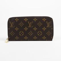 """Louis Vuitton Monogram Coated Canvas """"Zippy"""" Wallet - $860.00"""