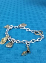 VINTAGE COLLECTIBLE SILVER COLOR METAL CHARM BRACET WITH SIX CHARMS - $15.99