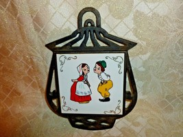 Trivet Cast Iron With Tile Cute Boy and Girl Design - $20.00