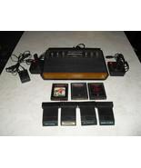Atari 2600 6 SWITCH with joysticks, adapter, 7 games combat, air sea battle - $178.19