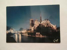 Paris France Notre Dame Illuminee Continental Sized Postcard - $2.99