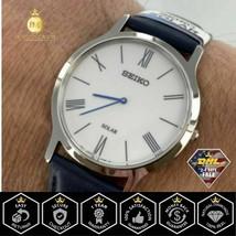 SEIKO Men's Watch Solar Quartz White Dial Blue Leather Strap Steel Case SUP857 - $94.38