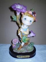 Belle & Benny Figurine/ fairy holding a beautiful flower - $53.60