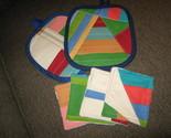 set of 2 strip pieced hotpads with 4 mug rugs