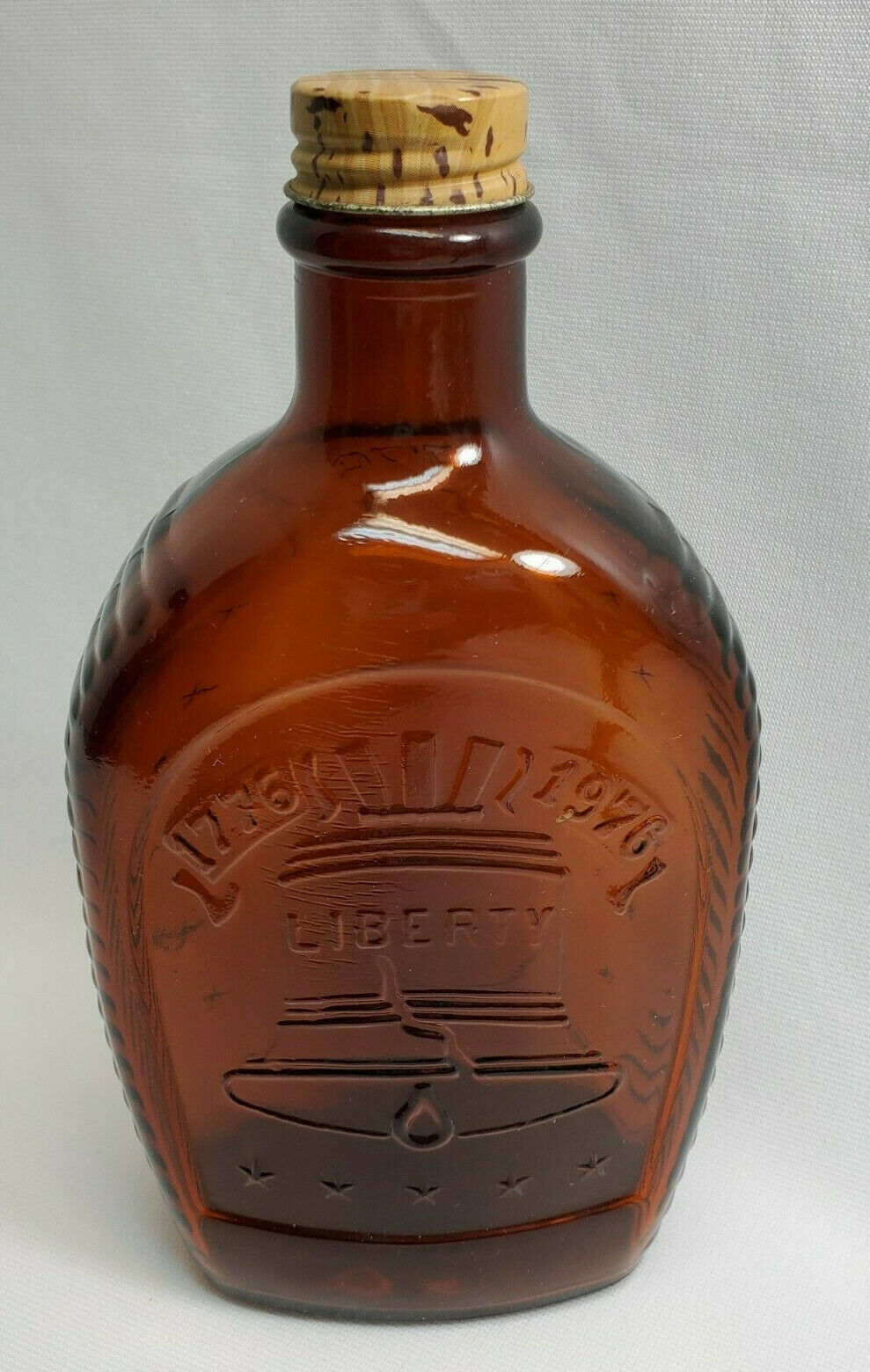 Primary image for Vintage Log Cabin Syrup Bottle Amber Bicentennial Liberty Bell 1776-1976