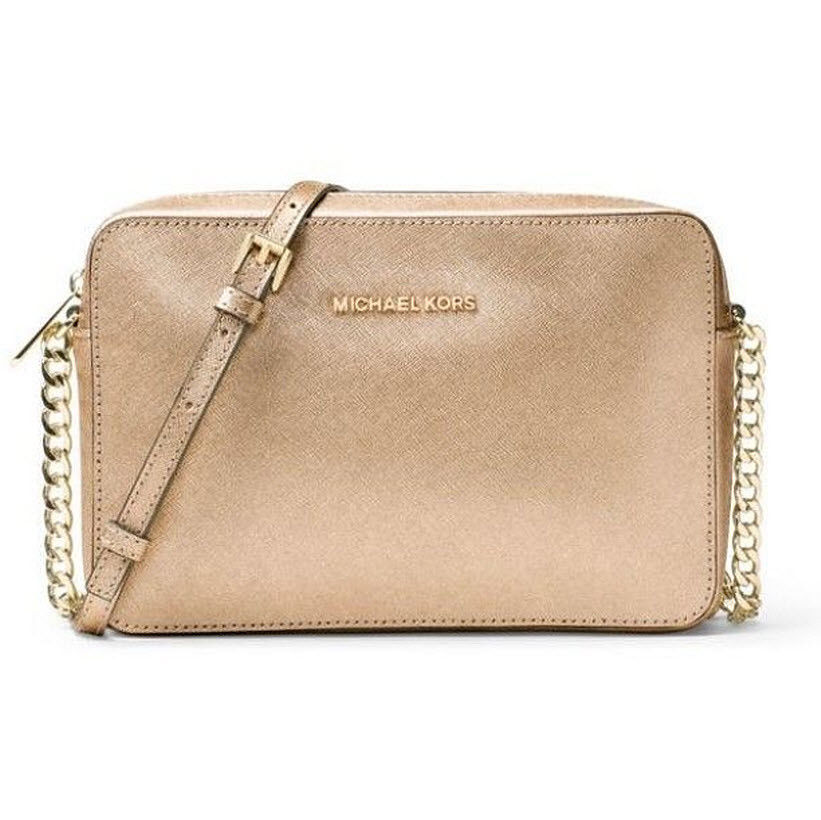 e4aa01d8bc92 57. 57. Michael Kors Jet Set Large East West Saffiano Leather Crossbody Bag  Pale gold