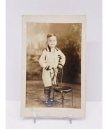 Vintage Postcard of a Young Boy In a Sailor Outfit Standing by Chair  - $7.70