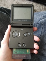 Gameboy SP with the simpsons night of the living tree house of horror - $55.00