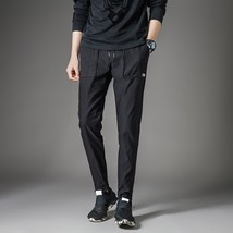 Spring and summer Korean men's Haren slim pants, casual sports pants - $47.94