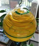 """Hanging Glass Ball 4"""" Diameter Yellow with Green Swirl Friendship Ball H... - $15.84"""
