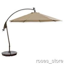 11-Foot Round Solar Cantilever Umbrella in Sunb... - $297.00