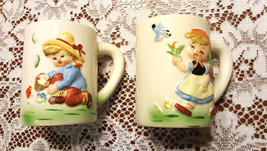 Hummel Coffee Mugs Tea Cups Boy & Girl Raised Relief 3D Lot of 2 Vintage - $20.00