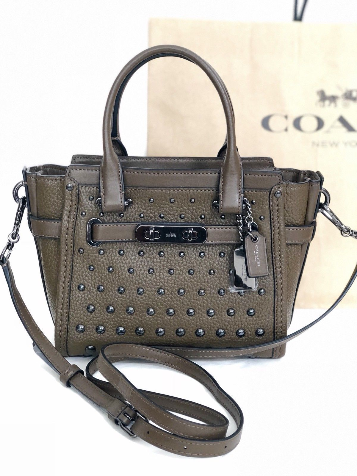 f0509091b1df 57. 57. Previous. NWT Coach 57696 Swagger 21 Ombre Rivets Pebble Leather  Handbag Fatigue Army  395