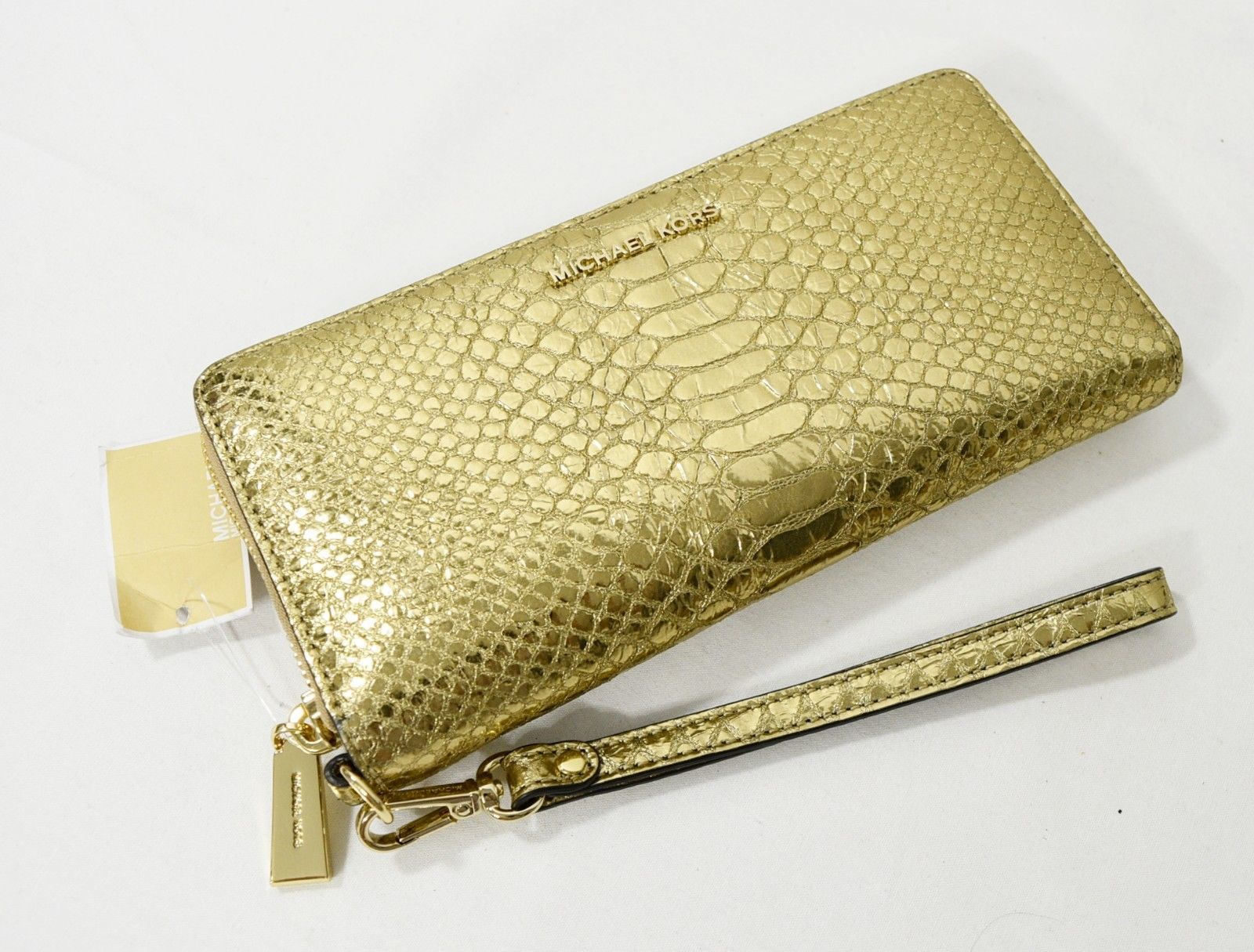 a5b96c1471d085 57. 57. Previous. Michael Kors Jet Set Travel Metallic Snake-Embossed-Leather  Continental Wristlet · Michael ...
