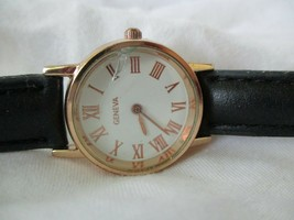 Geneva Analog Wristwatch with a Buckle Band and Quartz Movement - $29.00