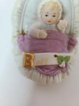 Enesco Growing up Ceramic Baby Girl In Carrier Basket Porcelain Figurine... - $30.88