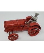 VINTAGE CAST IRON MCCORMICK DEERING TOY FARM TRACTOR WITH DRIVER - $56.43