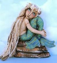 Mermaid on a rock thumb200
