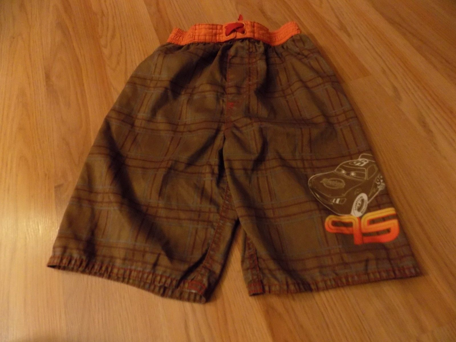 5cfd42c2a1 S l1600. S l1600. Previous. Boy's Size 4 Disney Cars Lightening McQueen  Brown Plaid Swim Trunks Board Shorts