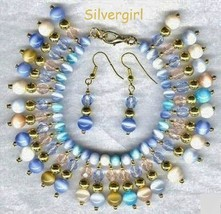 Shimmering Cat's Eye Charm Bracelet Earrings - $29.99