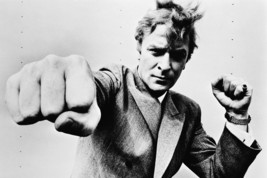 Michael Caine Punching At Camera 60's 18x24 Poster - $23.99