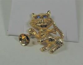 Avon Gold Tone Cat Pin Brooch, Blue Rhinestone Eyes, Holding Bell - $12.86