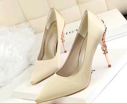 pp338 Excellent pointy pump w metallic heel,satin surface.US Size 4-8.5,champion - $48.80