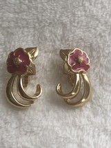 Vintage gold tone clip on earrings with pink enamel flowers - $8.00